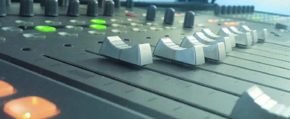 closeup of  faders of a DAW controller used for sound design and film mixing